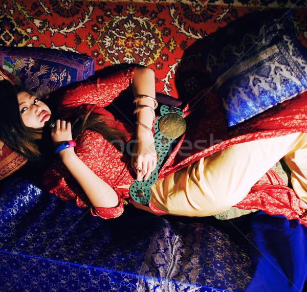 young pretty asian girl in bright colored interior Stock photo © iordani