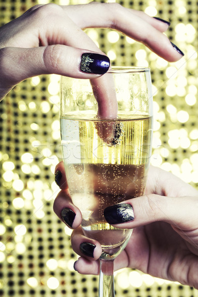 beauty close up photo fingers with manicure holding glass of champagne Stock photo © iordani