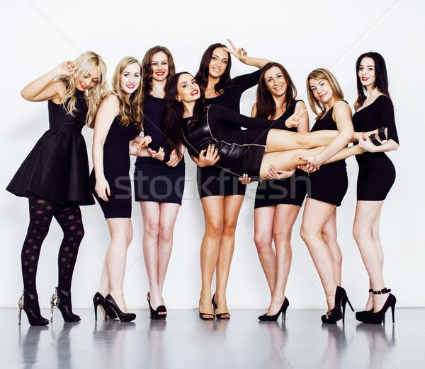 Many diverse women in line, wearing fancy little black dresses,  Stock photo © iordani