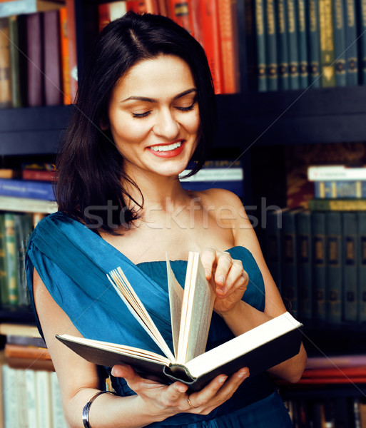 young teen brunette muslim girl in library among books emotional close up bookwarm, lifestyle smilin Stock photo © iordani