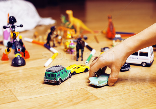children playing toys on floor at home, little hand in mess, fre Stock photo © iordani