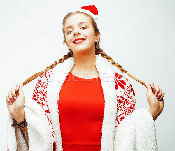 young pretty happy smiling blond woman on christmas in santas red hat and holiday decorated plaid, l Stock photo © iordani