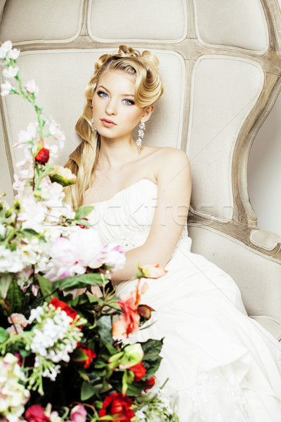 Stock photo: beauty young bride alone in luxury vintage interior with a lot of flowers close up, bridal style