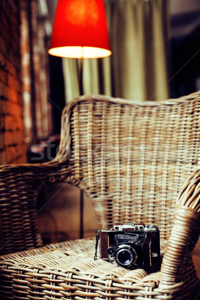 post card view. old fashion film camera in wooden chair, noone in cozy home interior Stock photo © iordani