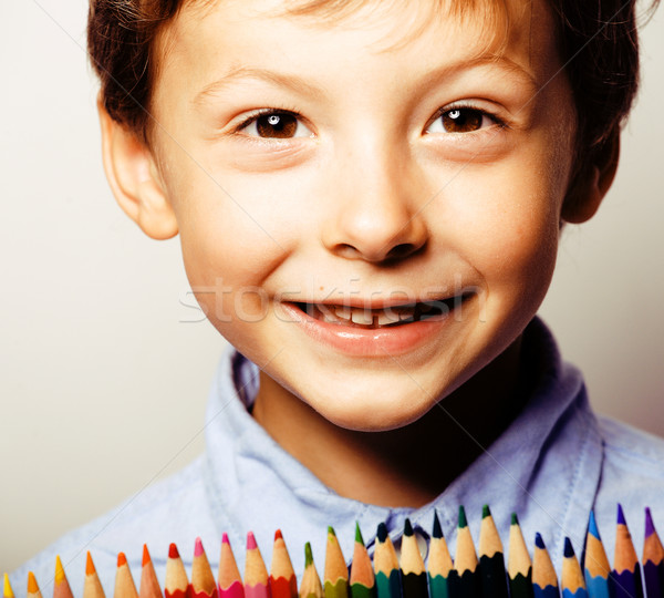 little cute boy with color pencils close up smiling, education f Stock photo © iordani