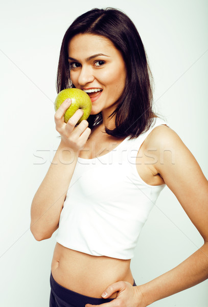 portrait of sporty young woman with green apple isolated on white background Stock photo © iordani