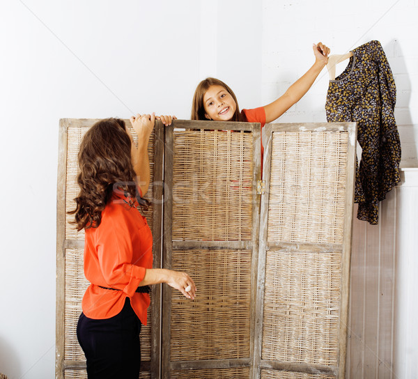 happy mother with daughter trying on dresses at home interior, h Stock photo © iordani