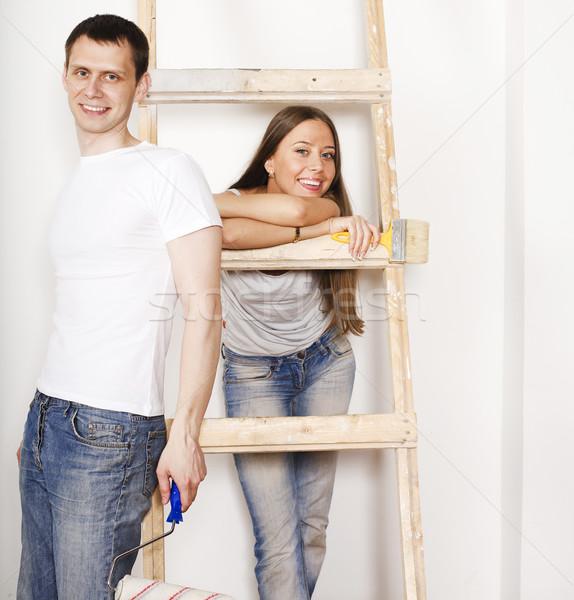 Boldog család javítás mosolyog fiatal pér létra fehér Stock fotó © iordani