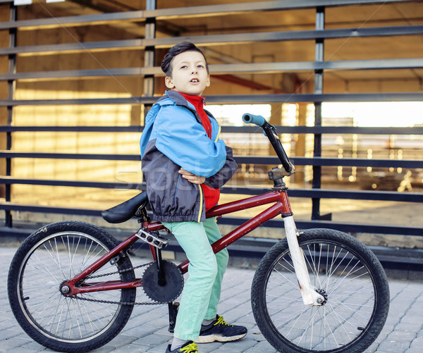 young kid on cool bmx bicycle riding outside, lifestyle people concept  Stock photo © iordani
