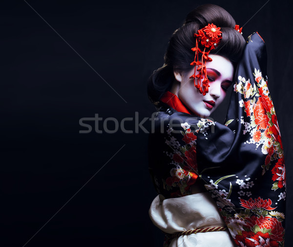 Stock photo: young pretty geisha in kimono with sakura and decoration