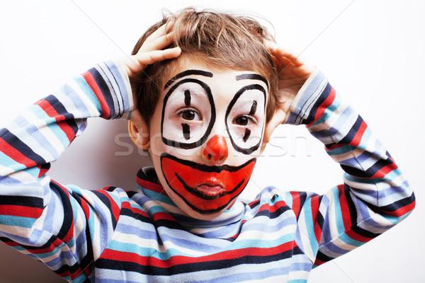 little cute boy with facepaint like clown, pantomimic expression Stock photo © iordani