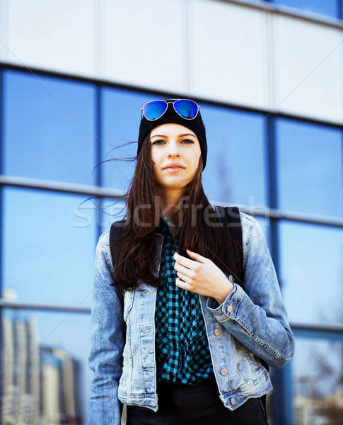 Stock photo: young pretty girl near business building walking