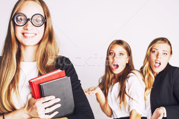 new student bookwarm in glasses against casual group on white, t Stock photo © iordani