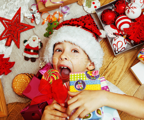 little cute kid in santas red hat with handmade gifts, toys vint Stock photo © iordani