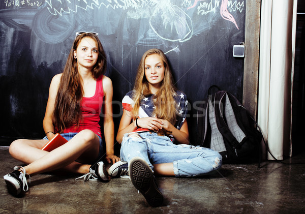 back to school after summer vacations, two teen real girls in classroom with blackboard painted toge Stock photo © iordani