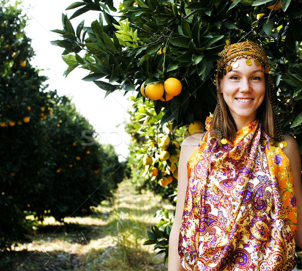 pretty islam woman in orange grove smiling, real muslim girl Stock photo © iordani