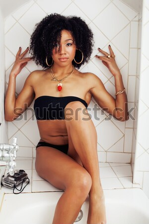 beauty young african american woman in bathrobe with tooth brush Stock photo © iordani