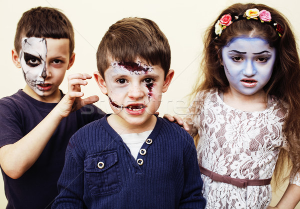zombie apocalypse kids concept. Birthday party celebration facepaint on children dead bride, scar fa Stock photo © iordani