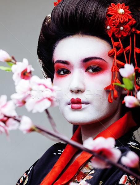 Genç güzel geyşa siyah kimono sakura Stok fotoğraf © iordani