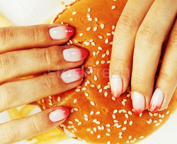 Kadın eller manikür hamburger patates kızartması Stok fotoğraf © iordani
