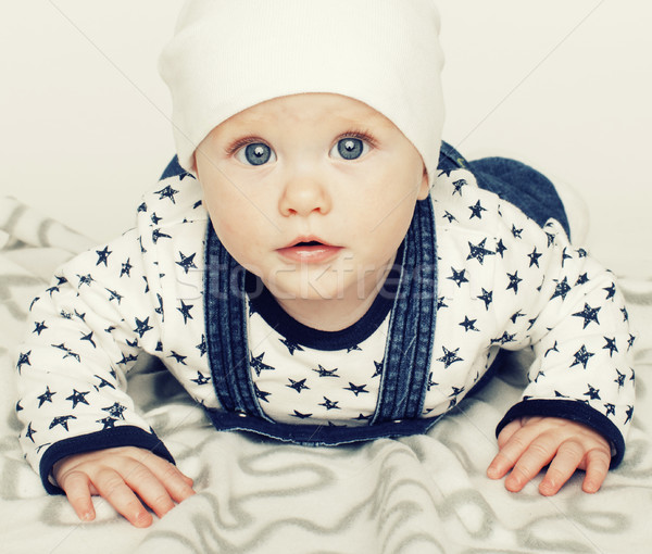 little cute baby toddler on carpet isolated close up smiling ado Stock photo © iordani