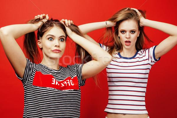 Stockfoto: Twee · tienermeisjes · samen · poseren