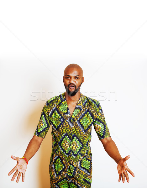 portrait of young handsome african man wearing bright green nati Stock photo © iordani