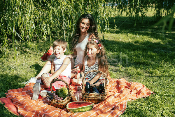Stock photo: cute happy family on picnic laying on green grass mother and kid