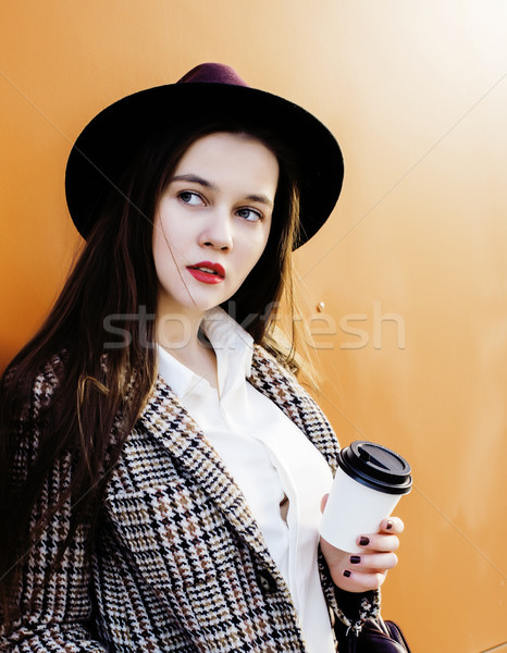 young pretty hipster girl student with coffee cup posing adorable smiling, lifestyle people concept  Stock photo © iordani