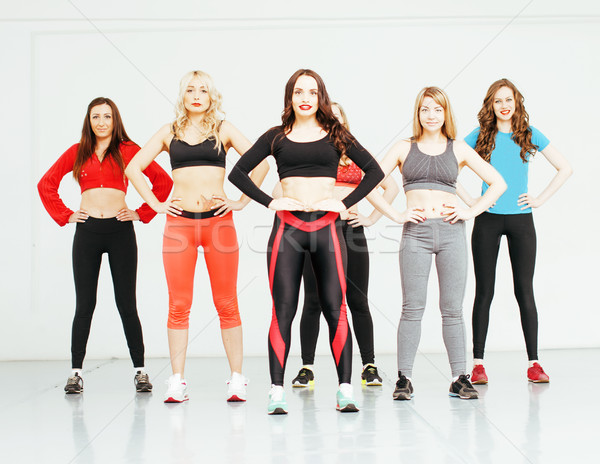 Women doing sport in gym, healthcare lifestyle people concept, modern loft studio Stock photo © iordani