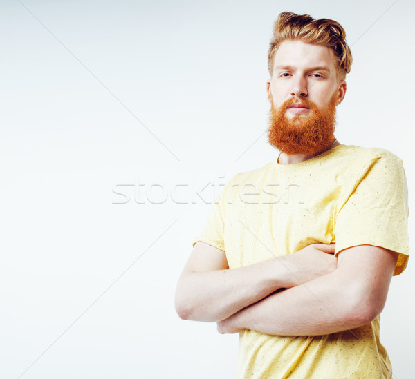 young handsome hipster ginger bearded guy looking brutal isolate Stock photo © iordani