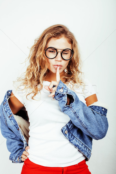 pretty young teenage girl blond curly hipster fashion glasses emotional posing happy smiling on whit Stock photo © iordani