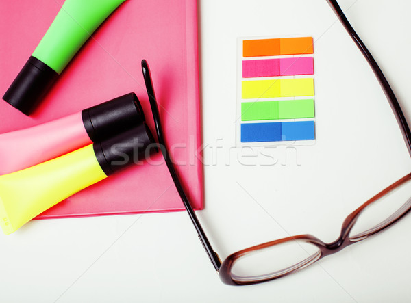 business, education and technology concept - close up of notebook, paper stickers, glasses, pencil d Stock photo © iordani