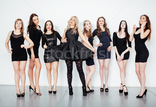 group of many cool modern girls friends in diverse fashion style black dress together having fun iso Stock photo © iordani