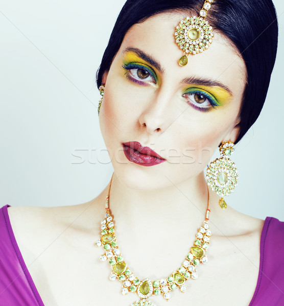 Stock photo: young pretty caucasian woman like indian in ethnic jewelry close up on white, bridal bright makeup f