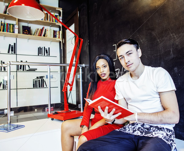 couple students in univercity library, looking book, preparing t Stock photo © iordani