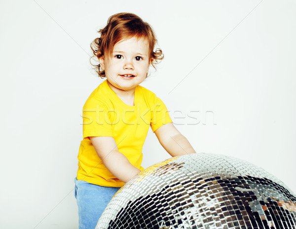 little cute adorable baby girl holding disco ball isolated on white close up, sweet real toddler Stock photo © iordani