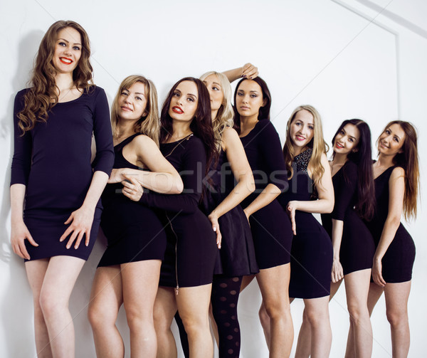 Many diverse women in line, wearing fancy little black dresses, party makeup, vice squad concept  Stock photo © iordani