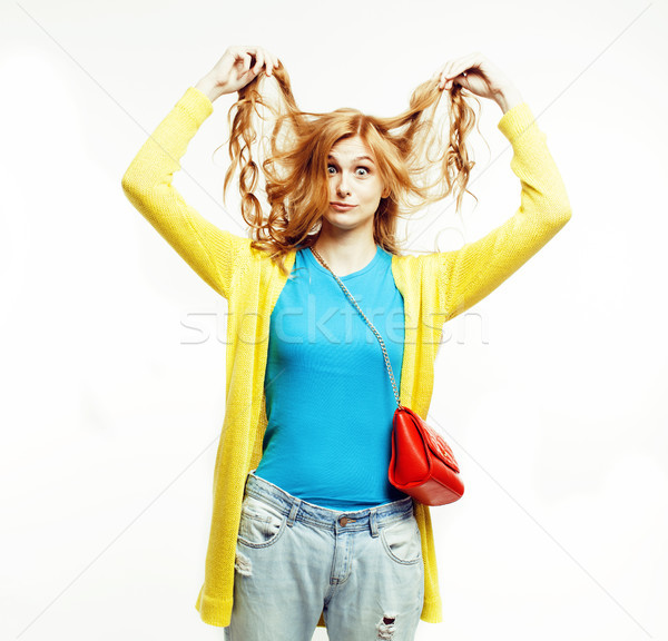 young pretty long red hair woman happy smiling isolated on white background, holding her curly hairs Stock photo © iordani