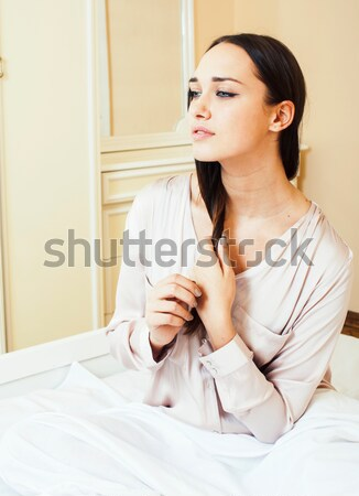 crying woman laying in bed depressed, real blond Stock photo © iordani