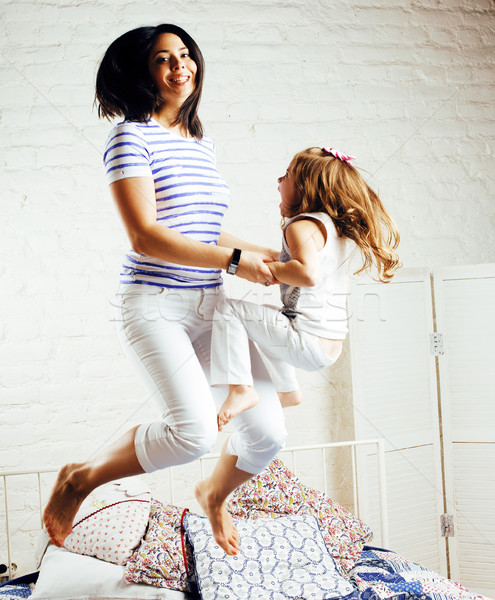 portrait of happy mother and her daughter playing in bad, lifestyle people concept Stock photo © iordani