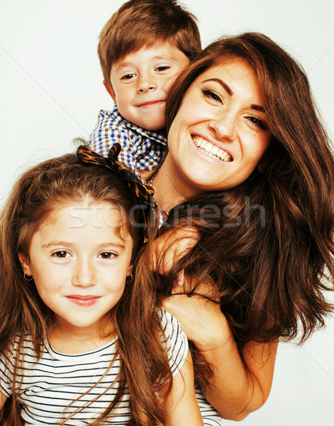 two pretty children kissing their mother happy smiling close up, Stock photo © iordani