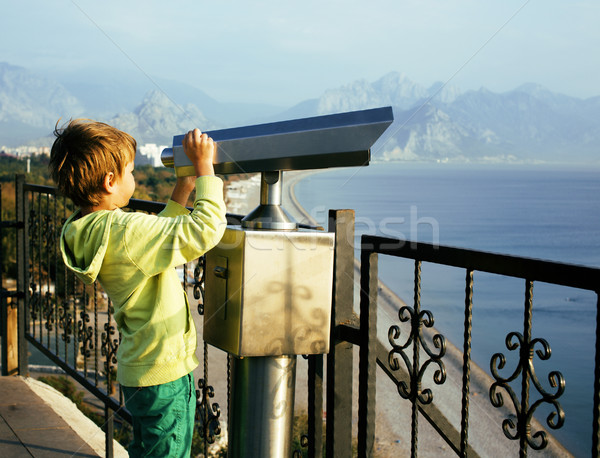 little cute boy looking through telescope at sea viewpoint in Ataturk park Stock photo © iordani