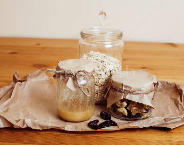 real comfort wooden kitchen with breakfast ingredients close up in glass, honey, oatmeal, milk, mues Stock photo © iordani