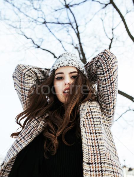 young pretty stylish teenage girl outside on city street fancy fashion dressed drinking milk shake,  Stock photo © iordani