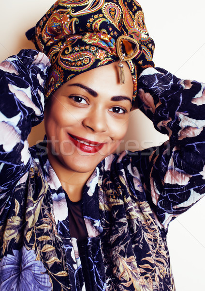 beauty bright real african woman with creative makeup, shawl on head like cubian closeup smiling Stock photo © iordani