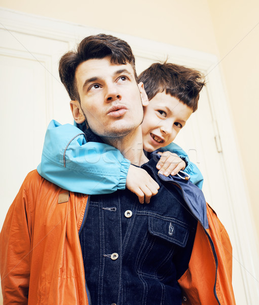 young handsome father with his son fooling around at home, lifestyle people concept Stock photo © iordani