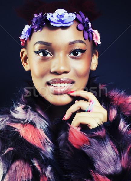 Fiatal csinos afroamerikai nő szőrmebunda virágok Stock fotó © iordani