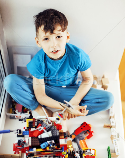 little cute preschooler boy playing lego toys at home happy smil Stock photo © iordani