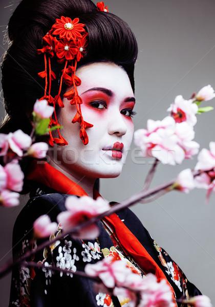 Fiatal csinos gésa kimonó sakura dekoráció Stock fotó © iordani